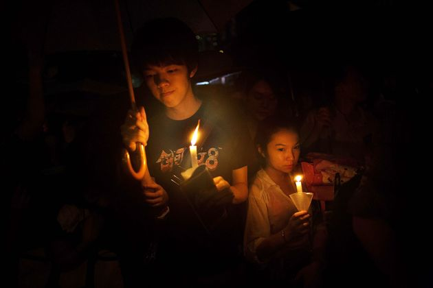 HONG KONG - JUNE 04: People take part in a candlelight vigil on the 24th anniversary of the Tiananmen...