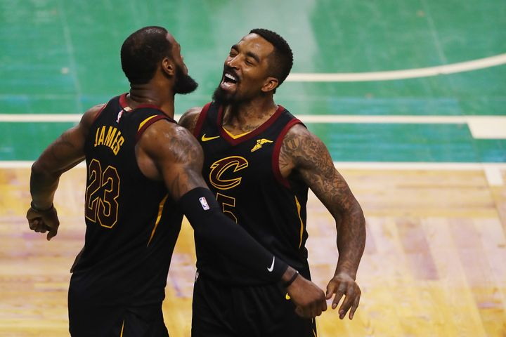 J.R. Smith, right, celebrates a playoff victory in 2018 with LeBron James.