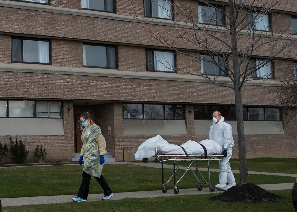 A body is wheeled from the Eatonville Care Centre in Toronto on April 14, 2020. The brutal assault of...