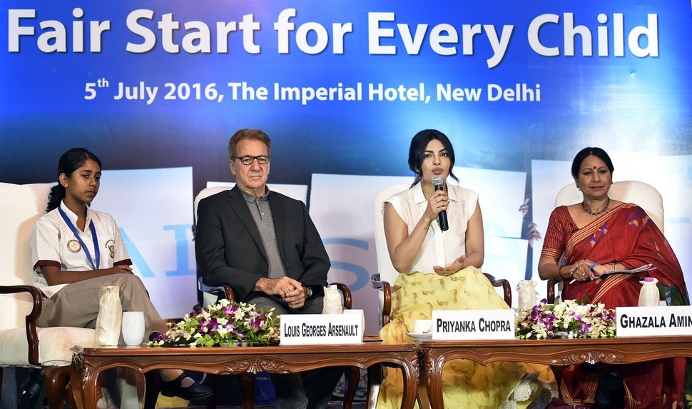 NEW DELHI, INDIA - JULY 5: Bollywood actress and UNICEF National Ambassador Priyanka Chopra along with UNICEF Representative to India Louis-Georges Arsenault and media personality Ghazala Amin during the discourse on #FairStart campaign for every child organized by UNICEF at Imperial Hotel on July 5, 2016 in New Delhi, India. (Photo by Raj K Raj/Hindustan Times via Getty Images)