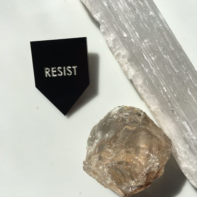 """Get the """"Resist"""" pin from Rayo & Honey for $12"""