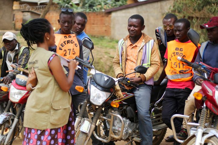 Martine Milonde, left, a Congolese community mobilizer who works with the aid group World Vision in Beni, eastern Congo, whic