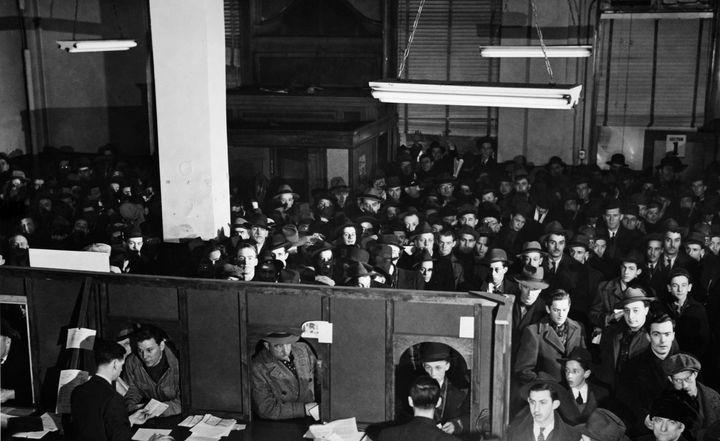 A counter for registration at an unemployment insurance office in Canada 1943.