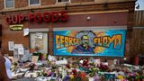 MINNEAPOLIS , MINNESOTA - MAY 31: A woman defies  curfew to pay her respects at the makeshift memorial and mural outside Cup Foods where George Floyd was murdered by a Minneapolis  police officer on Sunday, May 31, 2020 in Minneapolis , Minnesota. (Jason Armond / Los Angeles Times via Getty Images)