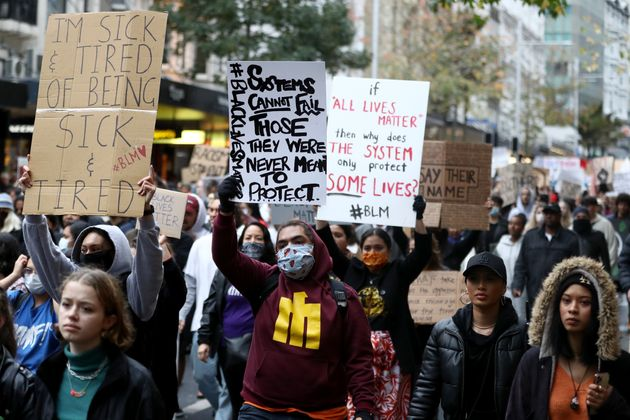 AUCKLAND, NEW ZEALAND - JUNE 01: Protestors march down Queen Street on June 01, 2020 in Auckland, New...