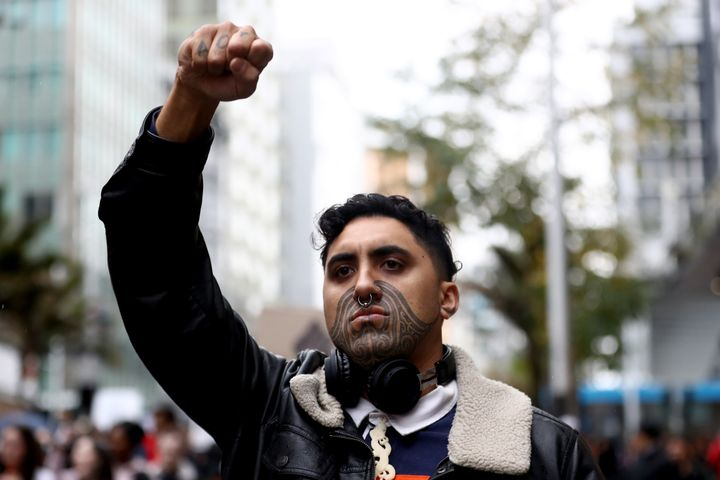 AUCKLAND, NEW ZEALAND - JUNE 01: A protestor marches down Queen Street on June 01, 2020 in Auckland, New Zealand. The rally was organised in solidarity with protests across the United States following the killing of an unarmed black man George Floyd at the hands of a police officer in Minneapolis, Minnesota. (Photo by Hannah Peters/Getty Images)