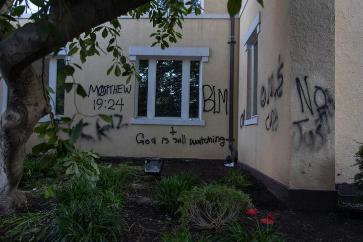 "Graffiti says ""God is still watching"" on the exterior walls of St. John's Episcopal Church near the White House on June 1, 20"