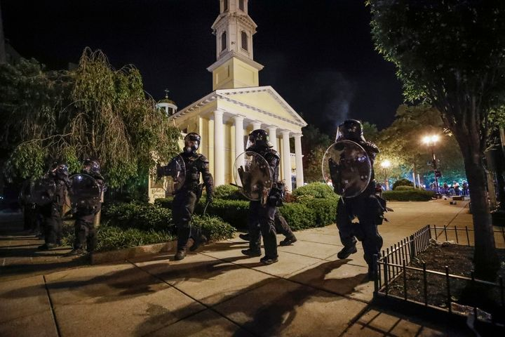 Police form a line in front of St. John's Episcopal Church on May 31, 2020, near the White House in Washington.