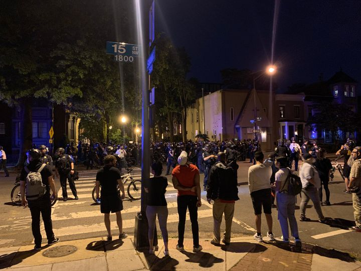 Police trap demonstrators on Swann Street NW in Washington, D.C.