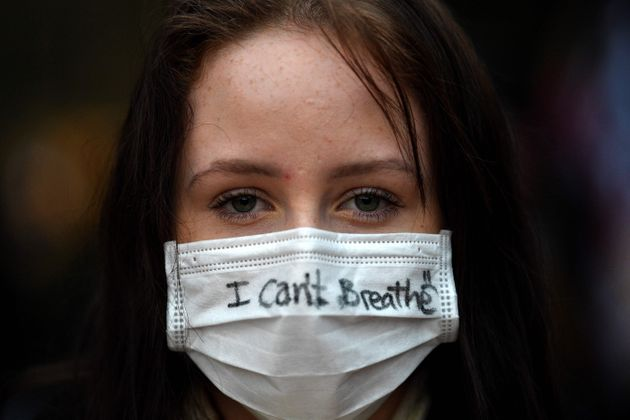 A protester wears a face mask during a rally for justice in Sydney on June 2, 2020, against the deaths of members of the Aboriginal community in Australia and the death of George Floyd.