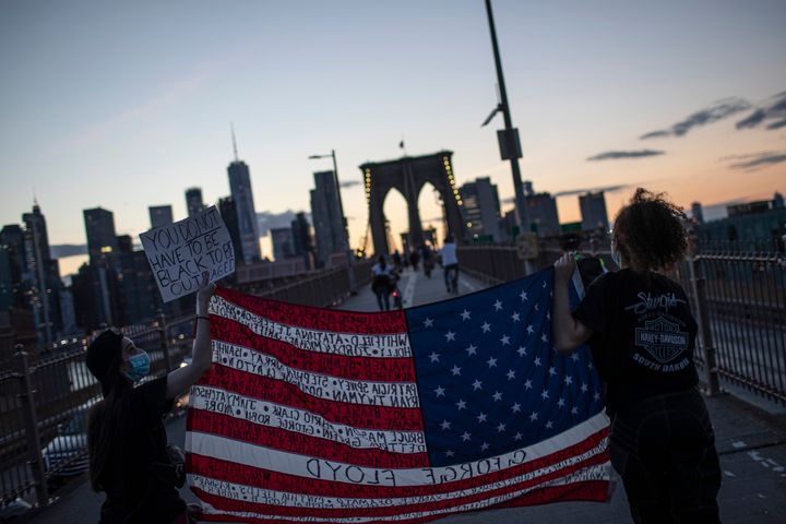 Protesters march across the Brooklyn Bridge as part of a solidarity rally calling for justice over the death of George Floyd