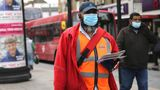 A postman wearing protective personal equipment walks through East Ham, east London, as the UK continues in lockdown to help curb the spread of the coronavirus. Picture date: Tuesday April 28, 2020.