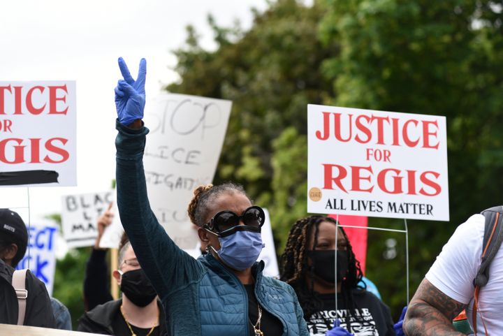 A family member ofRegis Korchinski-Paquet attends an anti-racism rally in Toronto on May 30, 2020. Ontario's Special Investigations Unit is investigating the 29-year-old's balcony fall death after her family questioned the role of police officers.