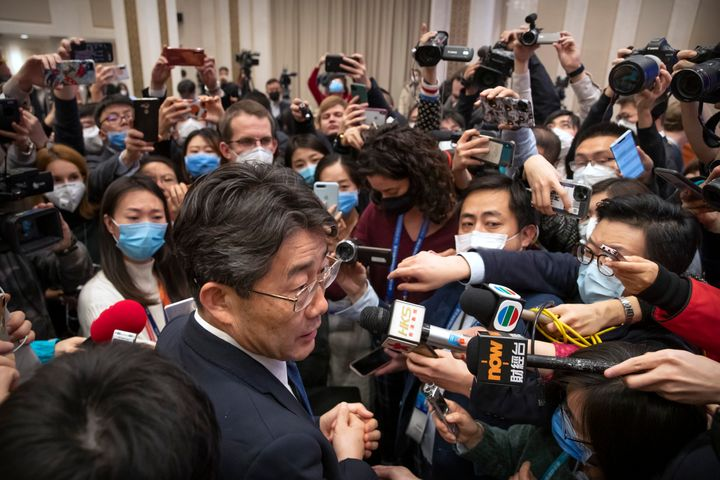Gao Fu, bottom, the head of the Chinese Center for Disease Control and Prevention (CDC), speaks to journalists after a press
