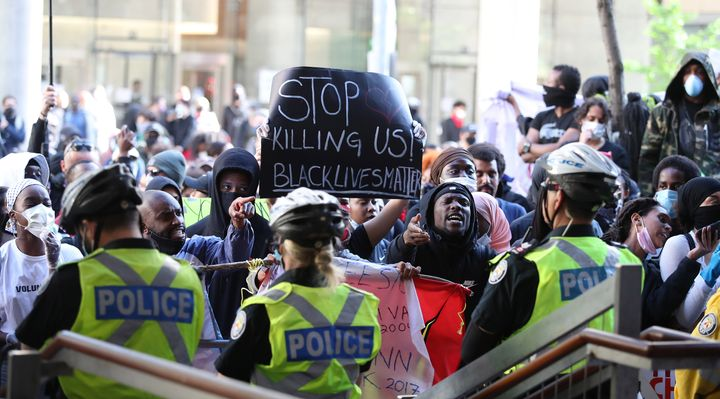 Activists and protesters rally in front of Toronto police headquarters on May 30, 2020 after the death of 29-year-old Regis Korchinski-Paquet.
