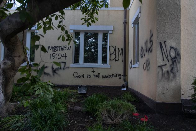 St. John's Episcopal Church covered in spray paint after