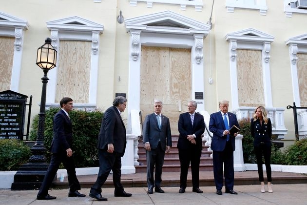 Trump stands outside St. John's Church on Monday with Defense Secretary Mark Esper, Attorney General...