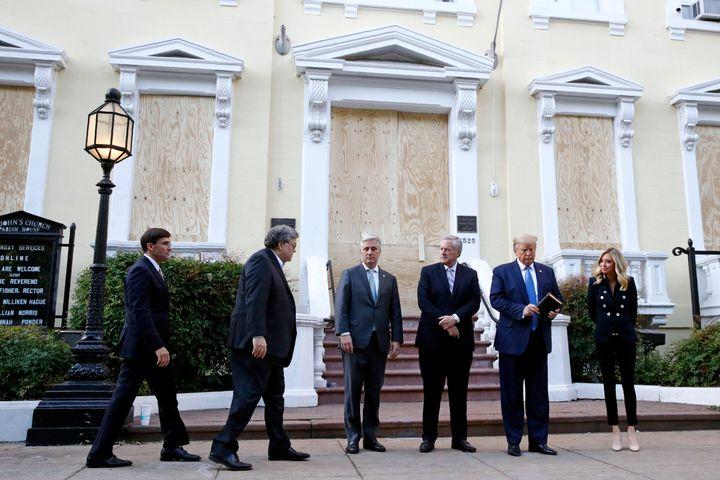 Trump stands outside St. John's Church on Monday with Defense Secretary Mark Esper, Attorney General Bill Barr, national secu