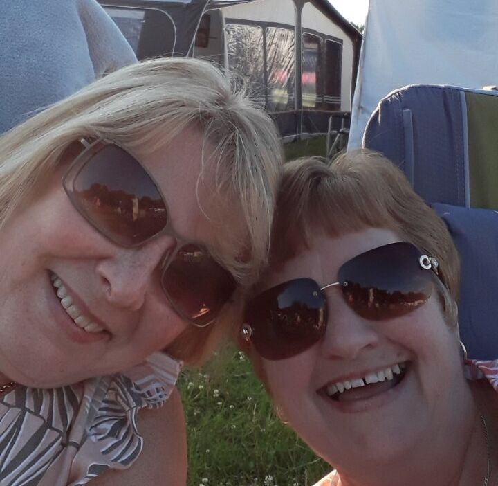 Fiona and a friend raising a glass on holiday