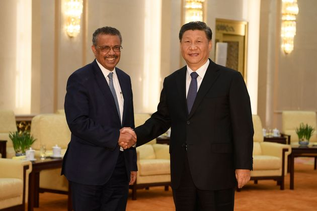 Tedros Adhanom Ghebreyesus, the WHO's director-general, shakes hands with Chinese President Xi Jinping...