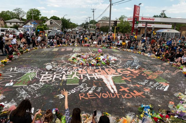 People gather on June 1 at the site in Minneapolis where George Floyd died on May 25 while in police