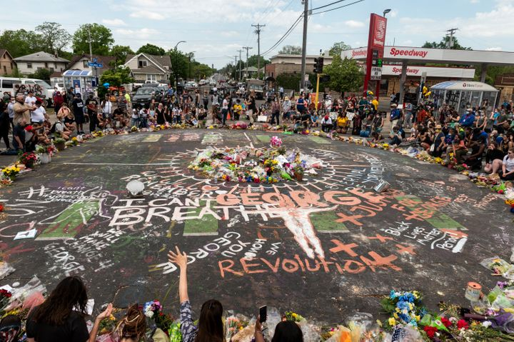 People gather on June 1 at the site in Minneapolis where George Floyd died on May 25 while in police custody.