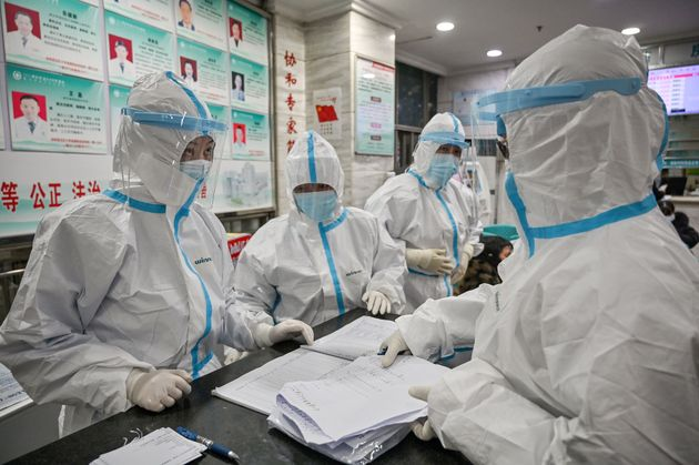 Medical staff members wear protective clothing at the Wuhan Red Cross Hospital in Wuhan on Jan. 25, 2020....