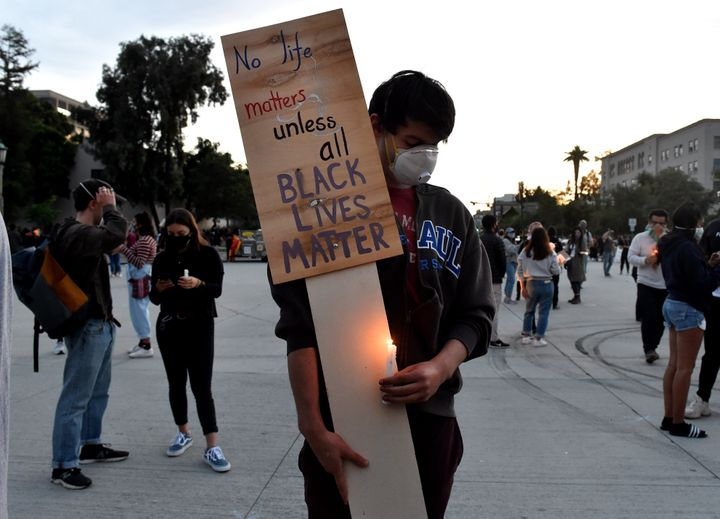 Alec Rosenatck waits for a protest and candlelight vigil in front of Pasadena City Hall on May 31 in California.