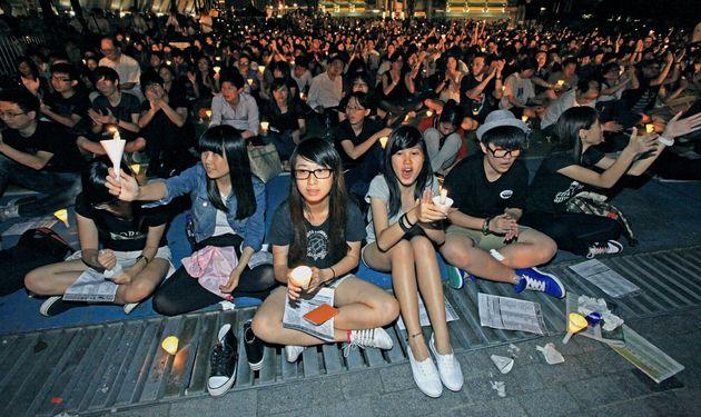 Hong Kong, Hong Kong SAR - June 3, 2012: Young Hong Kong people shouting and singing at traditional annual...