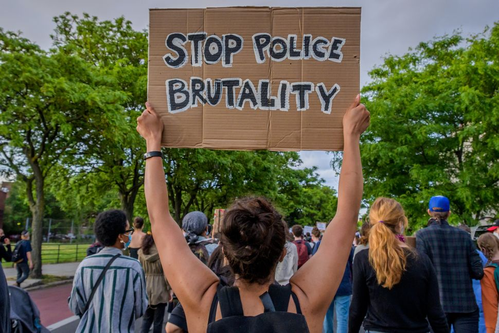 Hundreds of protesters flooded the streets of Crown Heights in Brooklyn to demand the defunding of the police force and to de