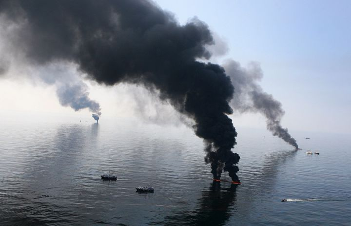 Smoke billows from a controlled burn of spilled oil off the Louisiana coast after the April 2010 Deepwater Horizon explosion