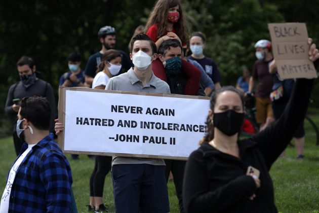 Demonstrators stage a protest near the Saint John Paul II National Shrine, which President Donald Trump...