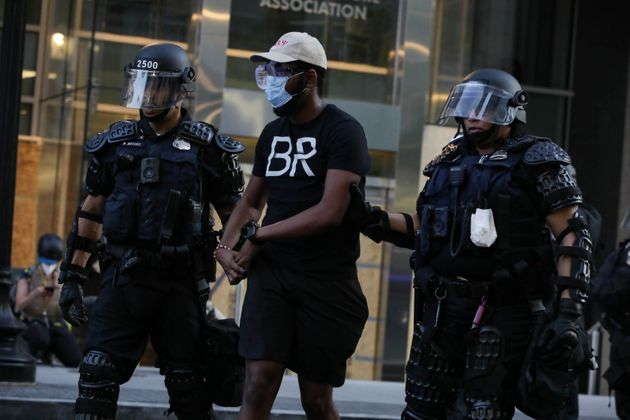 A protestor is being arrested by Washington D.C. Metropolitan Police officers during a protest over the...