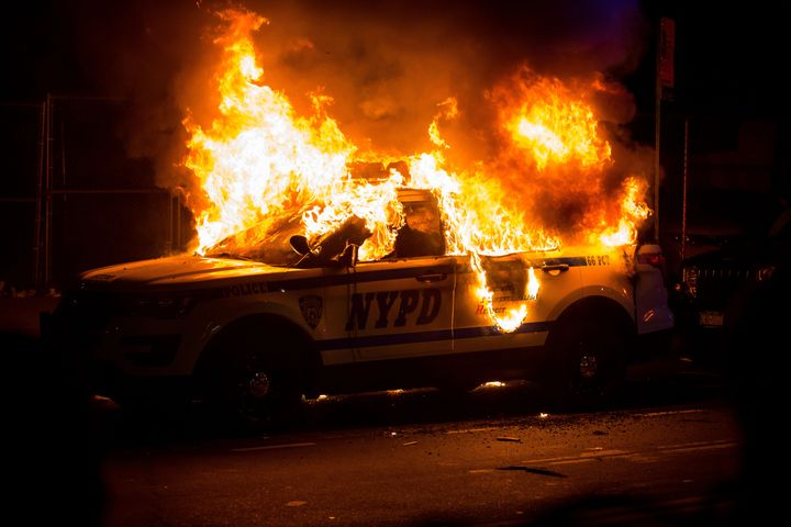 A New York Police Department SUV is burned Sunday during a Brooklyn protest over the police killing of George Floyd in Minneapolis.