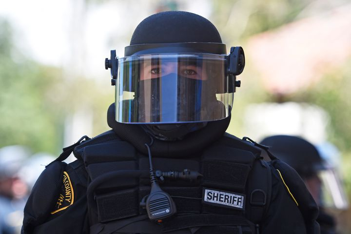 A Contra Costa County Sheriff deputy dressed in riot gear stands on Lincoln Ave. while on patrol in Walnut Creek, Calif., on