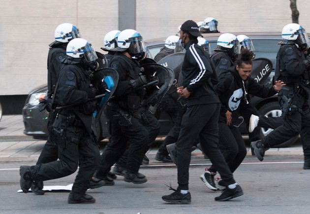 Police push back protesters during a demonstration on May 31, 2020 calling for justice in the death of...