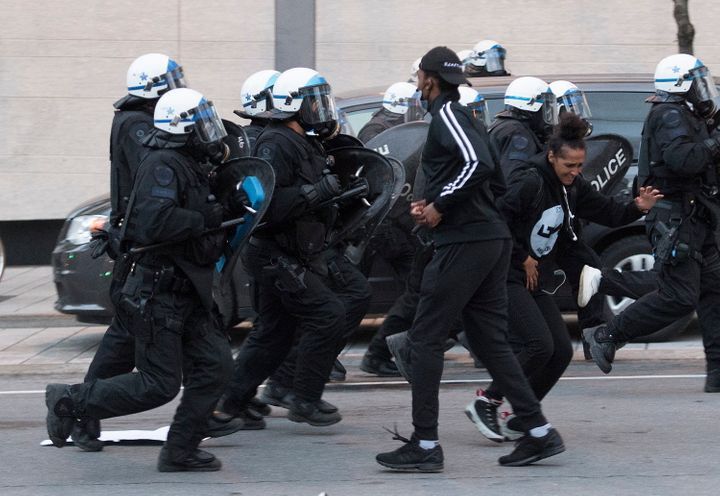 Police push back protesters during a demonstration on May 31, 2020 calling for justice in the death of George Floyd and victims of police brutality in Montreal.
