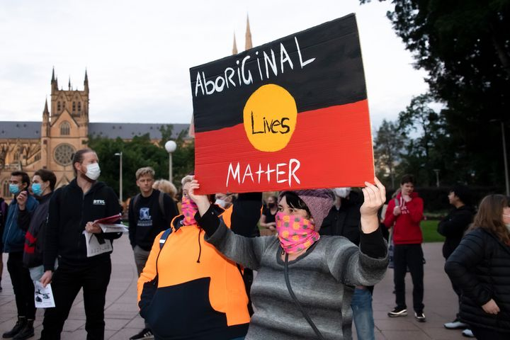 SYDNEY, AUSTRALIA - JUNE 02: Protesters hold up signs in Hyde Park during a 'Black Lives Matter' rally on 02 June, 2020 in Sydney, Australia. This event was organized to rally against aboriginal deaths in custody in Australia as well as in unity with protests across the United States following the killing of an unarmed black man George Floyd at the hands of a police officer in Minneapolis, Minnesota. (Photo by Speed Media/Icon Sportswire)