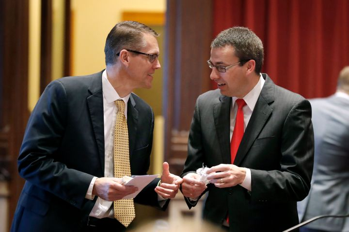 Sen. Randy Feenstra, left, talks with state Sen. Roby Smith in the Iowa Legislature in 2019. Feenstra will face Democrat J.D.