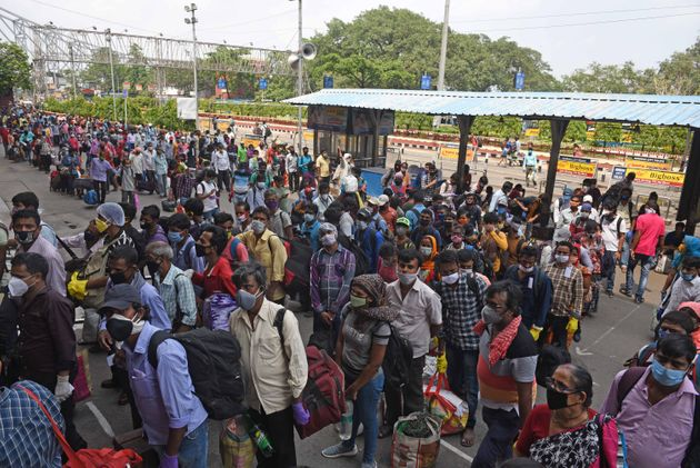Passengers queue up to enter Howrah station on June 1, 2020 in Kolkata,