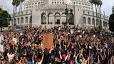 Demonstrators kneel in front of Los Angeles City Hall with their hands up during a protest Tuesday, June 2, 2020, in Los Angeles, over the death of George Floyd. Floyd died in police custody on Memorial Day in Minneapolis. (AP Photo/Mark J. Terrill)