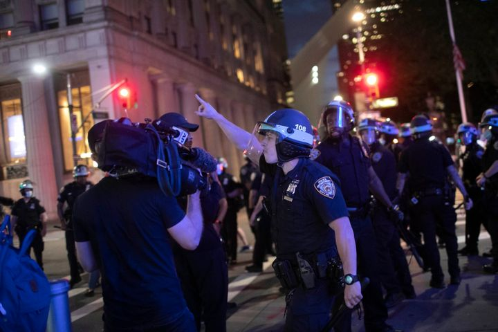 A police officer shouts at Associated Press videojournalist Robert Bumsted on June 2, 2020, in New York.