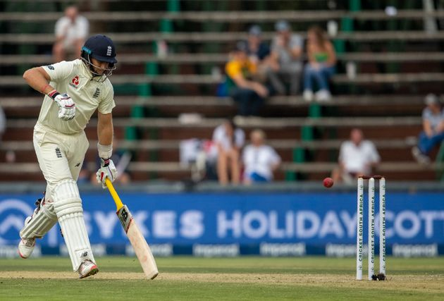 England's captain Joe Root makes a run on day one of the fourth cricket test match between South Africa...