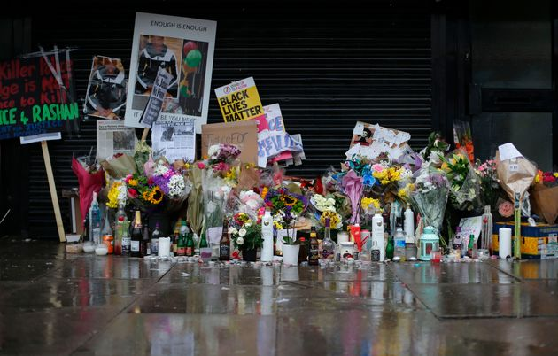 Floral tributes and candles in east London following the death of Rashan