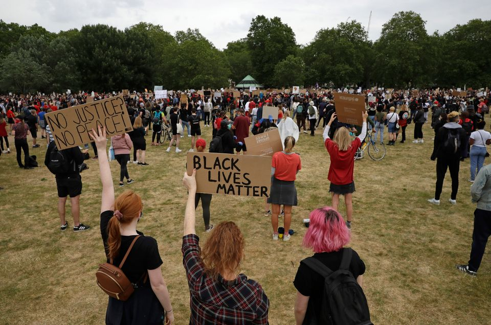 Protesters take part in a demonstration on Wednesday, June 3, 2020, in Hyde Park,
