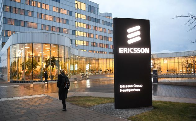 A woman walks past Ericsson headquarters in Stockholm, Sweden, Jan. 24,