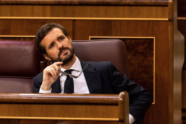 Spanish conservative People's Party (PP) leader Pablo Casado attends a plenary session at the parliament...