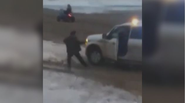 A screenshot from a video posted on YouTube shows a Nunavut RCMP vehicle slowly approaching a man before...