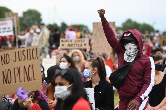People participate in a Black Lives Matter protest rally in Hyde Park, London, in memory of George Floyd...