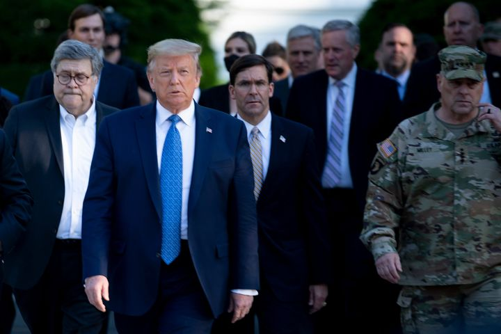 Defense Secretary Mark Esper and Chairman of the Joint Chiefs of Staff Mark Milley walk with Donald Trump to his photo-op at